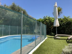 a barrier fence set up for pool safety