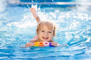 Young child swimming in pool
